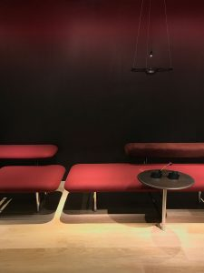 Red hombre wall and burgandy seating