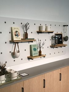 Wall with dowel shelving