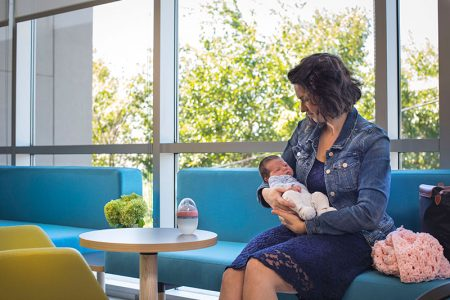 woman in waiting room with baby