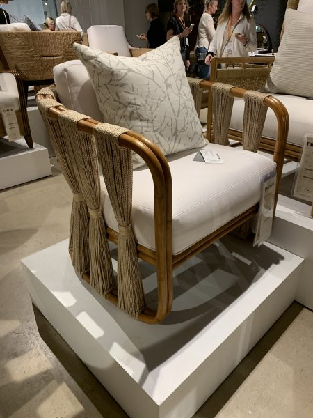 Wood framed chair with white upholstery