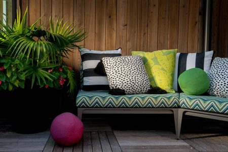bench with bright colored pillows