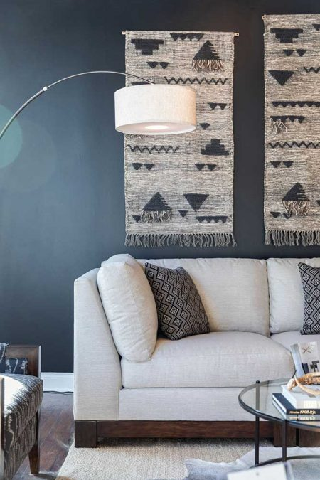 White sofa with textile accent on wall