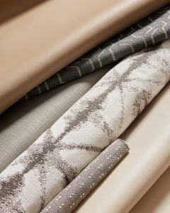 An array of styles and colors of Sunbrella fabrics, spanning jacquard patterns to synthetic leather.