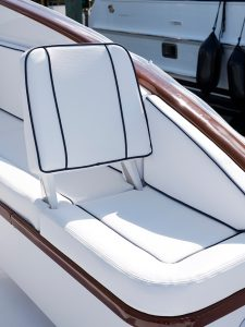 Crisp white Sunbrella Horizon fabric in Capriccio highlights sleek finishes aboard this King Fisher boat