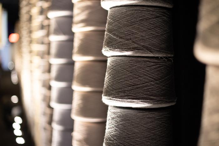 Large spools of Sunbrella eco friendly fabrics in their yarn form