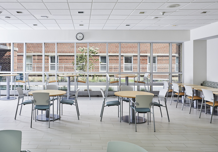 Sunbrella Contract fade resistant fabric saturates this hospital dining space with a calming palette, complementing the use of natural light.