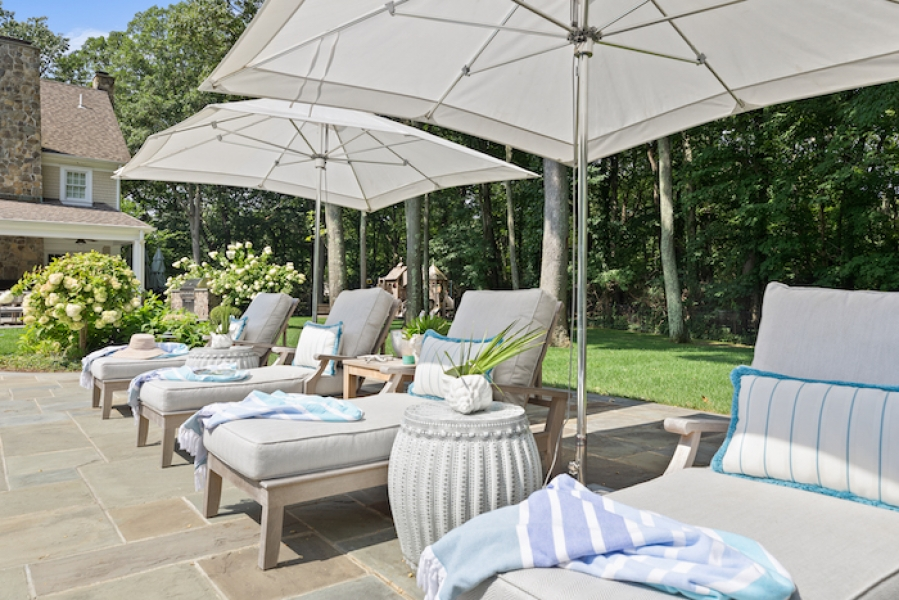 Pops of Tiffany blue add soft and subtle contrast to beige Sunbrella fabric outdoor cushions